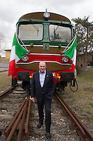 L'amministratore delegato delle Ferrovie dello Stato Michele Elia posa davanti a un treno d'epoca degli anni Venti in occasione della presentazione degli itinerari storici proposti dal Ministero dei Beni Culturali e del Turismo e dalla Fondazione FS Italiane, sui binari della stazione di Torrenieri-Montalcino, lungo il tracciato dell'antica ferrovia della Val d'Orcia, 11 aprile 2015.<br /> Italian Railways company (FS) CEO Michele Elia portrayed in front of a vintage train of the twenties traveling on the occasion of the presentation of the historical tours proposed by the Italian Culture and Tourism Minister and Fondazione FS Italiane (Italian Railways Foundation), at Torrenieri-Montalcino's railway station, along the Val d'Orcia, Tuscany, 11 April 2015.<br /> UPDATE IMAGES PRESS/Riccardo De Luca