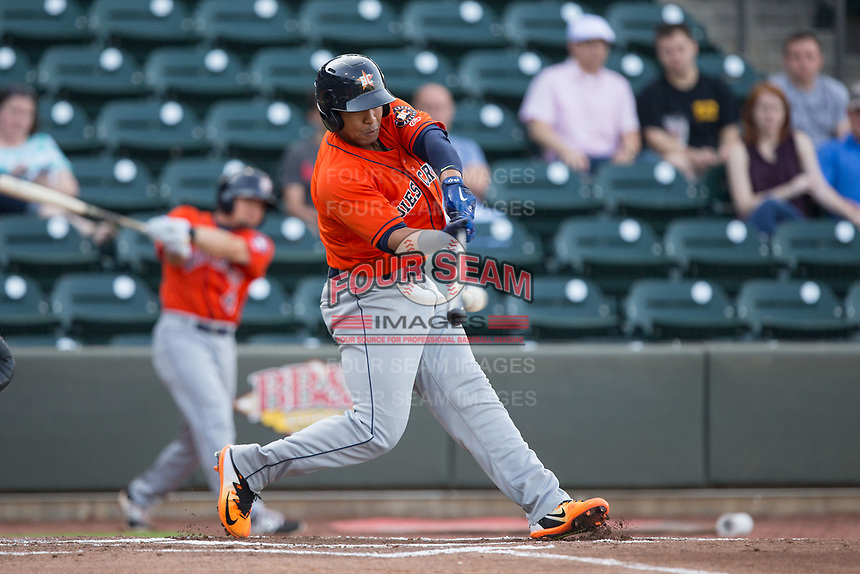 Dexture McCall (27) of the Buies Creek Astros makes contact with the baseball against the Winston-Salem Dash at BB&T Ballpark on April 15, 2017 in Winston-Salem, North Carolina.  The Astros defeated the Dash 13-6.  (Brian Westerholt/Four Seam Images)