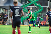 LAKE BUENA VISTA, FL - JULY 14: Christian Roldan #7 of the Seattle Sounders dribbles the ball during a game between Seattle Sounders FC and Chicago Fire at Wide World of Sports on July 14, 2020 in Lake Buena Vista, Florida.