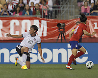 USWNT substitute forward Abby Wambach (20) looks for a whistle. In an international friendly, the U.S. Women's National Team (USWNT) (white/blue) defeated Korea Republic (South Korea) (red/blue), 4-1, at Gillette Stadium on June 15, 2013.