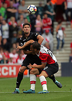 (L-R) Federico Fernandez of Swansea City challenges Manolo Gabbiadini of Southampton during the Premier League match between Southampton and Swansea City at the St Mary's Stadium, Southampton, England, UK. Saturday 12 August 2017
