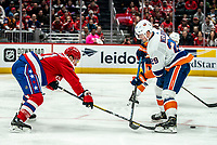 WASHINGTON, DC - JANUARY 31: Garnet Hathaway #21 of the Washington Capitals  poke checks the puck away from Brock Nelson #29 if the New York islanders during a game between New York Islanders and Washington Capitals at Capital One Arena on January 31, 2020 in Washington, DC.