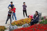 Yangzhou, Jiangsu, China.  Chinese Taking Photos in the Slender West Lake Park.