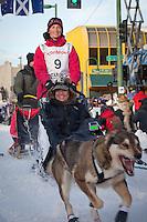 Musher Zoya DeNure and Iditarider John McCaskey.leave the 2011 Iditarod ceremonial start line in downtown Anchorage, Alaska