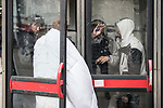 © Joel Goodman - 07973 332324 . 06/04/2017 . Manchester , UK . Four people huddle in to two telephone boxes and consume rolled cigarettes , believed to contain spice . An epidemic of abuse of the drug spice by some of Manchester's homeless population , in plain sight , is causing users to experience psychosis and a zombie-like state and is daily being witnessed in the Piccadilly Gardens area of Manchester , drawing large resource from paramedic services in the city centre . Photo credit : Joel Goodman