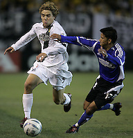 29 October 2005:  Chris Albright of the LA Galaxy dribbles the ball away from Mark Chung of the Earthquakes at Spartan Stadium in San Jose, California.   LA Galaxy defeated Earthquakes, 4-2 in two games.