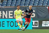FOXBOROUGH, MA - MAY 12: Damia Viader #3 of Union Omaha passes the ball as Connor Presley #7 of New England Revolution II closes during a game between Union Omaha and New England Revolution II at Gillette Stadium on May 12, 2021 in Foxborough, Massachusetts.
