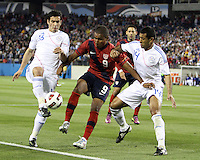 Juan Agudelo(9) of the USA MNT takes the ball past Marcos Riveros(16) and Paulo Cesar Da Silva(14) of Paraguay during an international friendly match at LP Field, in Nashville, TN. on March 29, 2011. Paraguay won 1-0.