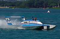 "Chip Hanauer, U-00 ""Atlas Van Lines"" (1982 Rolls-Royce powered Lucero hull) waves to the crowd."