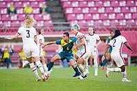 KASHIMA, JAPAN - JULY 27: Chloe Logarzo #6 of Australia defends the ball against Julie Ertz #8 of the United States and Sam Mewis #3 of the United States during a game between Australia and USWNT at Ibaraki Kashima Stadium on July 27, 2021 in Kashima, Japan.