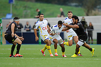 Wesley Fofana of ASM Clermont Auvergne is tackled by Billy Vunipola of Saracens during the European Rugby Champions Cup  Round 1 match between Saracens and ASM Clermont Auvergne at the Twickenham Stoop on Saturday 18th October 2014 (Photo by Rob Munro)