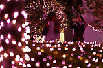 People take a picture under the illuminations at Shinjuku Terrace City on November 16, 2017, Tokyo, Japan. Shinjuku Terrace City Illuminations are seen around Odakyu Line Shinjuku Station. This year marks the 12th year of the illumination event, which can be enjoyed until February 22, 2018. (Photo by Rodrigo Reyes Marin/AFLO)