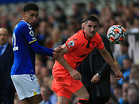 25th September 2021; Goodison Park, Liverpool, England; Premier League football, Everton versus Norwich; Ben Godfrey of Everton and Kenny McLean of Norwich City compete for the ball