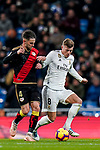 Toni Kroos of Real Madrid (R) fights for the ball with Alvaro Medran of Rayo Vallecano during the La Liga 2018-19 match between Real Madrid and Rayo Vallencano at Estadio Santiago Bernabeu on December 15 2018 in Madrid, Spain. Photo by Diego Souto / Power Sport Images