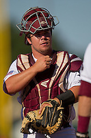 Texas A&M Aggie catcher Mitchell Nau #30 wrmas up prior to the NCAA Tournament Regional baseball game against the Dayton Flyers on June 1, 2012 at Blue Bell Park in College Station, Texas. The Aggies defeated the Flyers 4-1. (Andrew Woolley/Four Seam Images).
