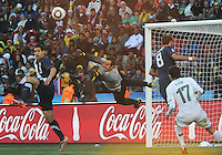 Slovenian goalkeeper Samir Handanovic punches the ball to safety on a dangerous cross. The United States came from a 2-0 halftime deficit to Slovenia to earn a 2-2 draw their second match of play in Group C of the 2010 FIFA World Cup.