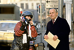 Female, motorcycle dispatch rider,<br />  giving pedestrian directions London Uk 1980S or 1990s