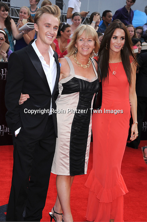 """Tom Felton and wife and mother arriving to the"""" Harry Potter and the Deathly Hallows- Part 2""""  North American Premiere on July 11, 2011 at Avery Fisher Hall in Lincoln Center in New York City."""