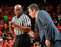 CHARLOTTESVILLE, VA- DECEMBER 6: Head coach Tony Bennett of the Virginia Cavaliers talks with a referee during the game on December 6, 2011 against the George Mason Patriots at the John Paul Jones Arena in Charlottesville, Virginia. Virginia defeated George Mason 68-48. (Photo by Andrew Shurtleff/Getty Images) *** Local Caption *** Tony Bennett