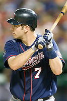 Minnesota Twins catcher Joe Mauer #7 at bat during a Major League Baseball game against the Texas Rangers at the Rangers Ballpark in Arlington, Texas on July 27, 2011. Minnesota defeated Texas 7-2.  (Andrew Woolley/Four Seam Images)