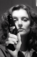 Woman with pistol in her hand<br />