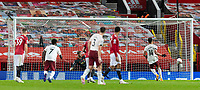 1st November 2020, Old Trafford, Manchester, England;  Arsenals Pierre-Emerick Aubameyang scores the only goal of the game from a penalty kick past Manchester United,  goalkeeper David de Gea during the English Premier League match between Manchester United FC and Arsenal FC at Old Trafford