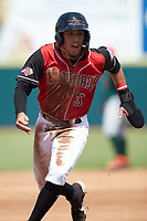 Jonathan Ornelas (3) of the Hickory Crawdads hustles towards third base against the Greensboro Grasshoppers at L.P. Frans Stadium on May 26, 2019 in Hickory, North Carolina. The Crawdads defeated the Grasshoppers 10-8. (Brian Westerholt/Four Seam Images)
