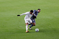 ST PAUL, MN - OCTOBER 28: Jonathan Lewis #7 of Colorado Rapids  and Jacori Hayes #5 of Minnesota United FC battle for the ball\ during a game between Colorado Rapids and Minnesota United FC at Allianz Field on October 28, 2020 in St Paul, Minnesota.