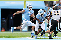 CHAPEL HILL, NC - SEPTEMBER 21: Sam Howell #7 of the University of North Carolina runs with the ball during a game between Appalachian State University and University of North Carolina at Kenan Memorial Stadium on September 21, 2019 in Chapel Hill, North Carolina.