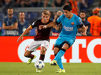 Calcio, Champions League, Gruppo E: Roma vs Barcellona. Roma, stadio Olimpico, 16 settembre 2015.<br /> FC Barcelona's Luis Suarez, right, is challenged by Roma's Lucas Digne during a Champions League, Group E football match between Roma and FC Barcelona, at Rome's Olympic stadium, 16 September 2015.<br /> UPDATE IMAGES PRESS/Riccardo De Luca
