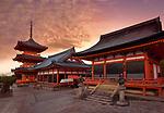Kiyomizu-dera Buddhist temple, Sanjunoto pagoda, Kaisan-do and Kyo-do hall. Beautiful sunrise scenery with dramatic red sky. Kyoto, Japan 2017. Image © MaximImages, License at https://www.maximimages.com
