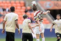 Houston, TX - Friday December 11, 2016: Drew Skundrich (12) of the Stanford Cardinal heads the ball towards the Wake Forest Demon Deacons goal at the NCAA Men's Soccer Finals at BBVA Compass Stadium in Houston Texas.