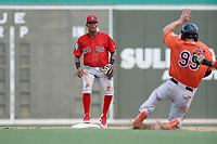 Boston Red Sox shortstop Antoni Flores (15) waits to receive a throw as Branden Becker (99) slides into second base during a Florida Instructional League game against the Baltimore Orioles on September 21, 2018 at JetBlue Park in Fort Myers, Florida.  (Mike Janes/Four Seam Images)