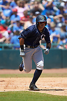 Wilkerman Garcia (24) of the Charleston RiverDogs hustles down the first base line against the Hickory Crawdads at L.P. Frans Stadium on May 13, 2019 in Hickory, North Carolina. The Crawdads defeated the RiverDogs 7-5. (Brian Westerholt/Four Seam Images)