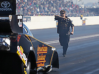 Feb. 22, 2013; Chandler, AZ, USA; NHRA crew member for funny car driver Tony Pedregon during qualifying for the Arizona Nationals at Firebird International Raceway. Mandatory Credit: Mark J. Rebilas-