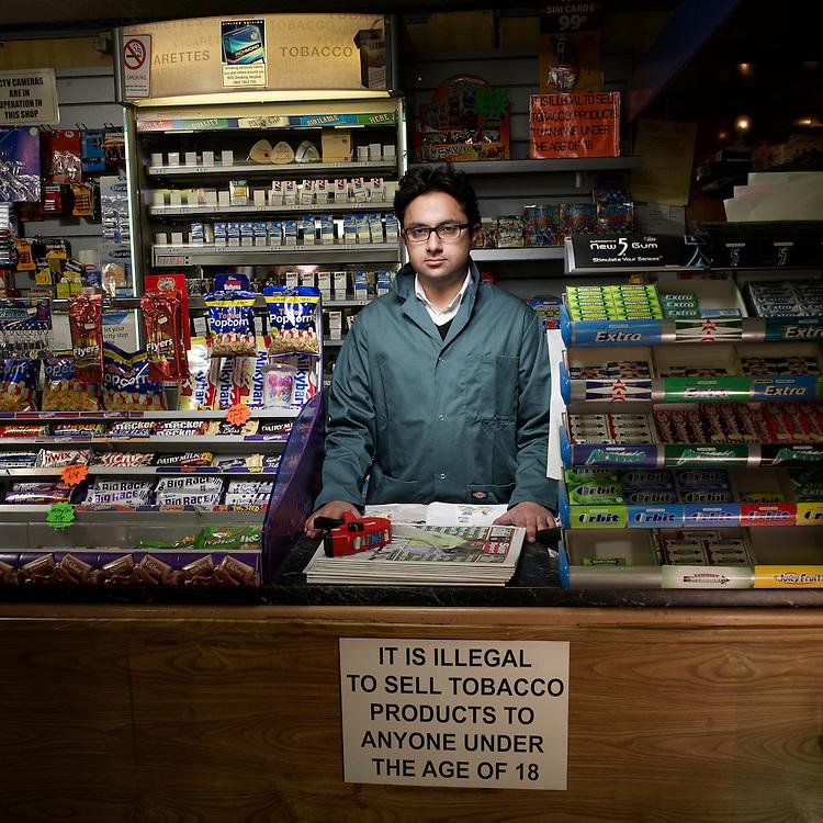 © John Angerson .Sathnam Sanghera working at the Kent news corner shop in Dudley, West Midlands.