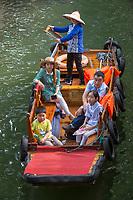 Suzhou, Jiangsu, China.  Chinese Family Taking Boat Ride on a Canal in Tongli Ancient Town near Suzhou.
