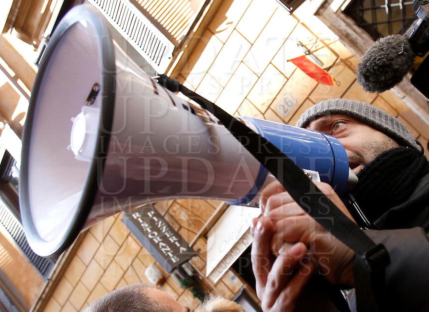 Manifestazione sotto la sede del Partito Democratico, per chiedere la chiusura dei Centri di Identificazione ed Espulsione (CIE) e dei Centri di Accoglienza per Richiedenti Asilo (CARA), a Roma, 27 dicembre 2013.<br /> Demonstrators attend a protest to ask for the closure of migrants Identification and Expulsion Centers (CIE) and Askers for Asylum Welcome Centers (CARA) in front of the Italian center-left Democratic Party's headquarters in Rome, 27 December 2013.<br /> UPDATE IMAGES PRESS/Isabella Bonotto