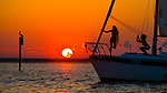 A fashion shoot aboard a sailboat during a sunset cruise at Shell Point Beach along the Forgotten Coast of Florida.