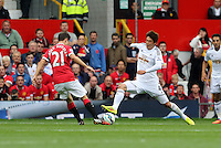 Pictured L-R: Ander Herrera of Manchester United against Ki Sung Yueng of Swansea. Saturday 16 August 2014<br />