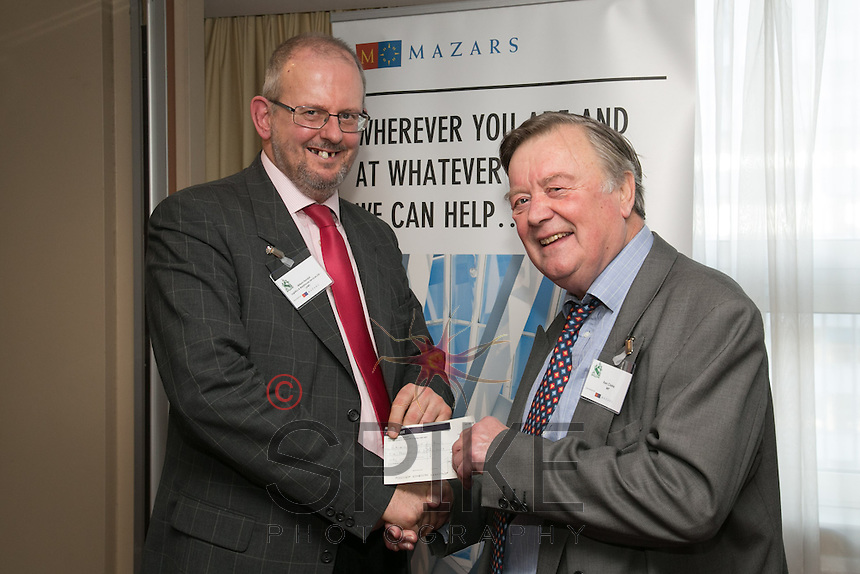 William Randall presents Ken Clarke MP with a cheque for £1,015, raised through Nottingham City Business Club's Christmas Lunch event for Parkinson's UK Nottingham Branch