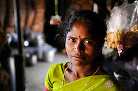 """INDIA Tamil Nadu Dindigul, portraits of young women which have worked in spinning units under the Sumangali scheme, a contract system, in which they are exploited instead of receiving a training and often do not receive the promised salary at the end of the contract / INDIEN Tamil Nadu, Dindigul , Portraets von Frauen die in der Textilindustrie in Spinnereien im Sumangali System gearbeitet haben, Sumangali bedeutet """"glueckliche Braut"""" und ist eine Form von Zwangsarbeit, junge Frauen erhalten einen Vertrag mit Versprechen auf Ausbildung und Zahlung einer Einmalsumme zum Ende der Laufzeit, sie arbeiten oft unter menschenunwuerdigen Bedingungen, werden teilweise sexuell von Vorarbeitern belaestigt und erhalten in vielen Faellen nicht die versprochene Entlohnung, Frau Panchavarnam 27 Jahre hat in einer Spinnerei gearbeitet und versucht mit Hilfe der NGO´s SSSSS und SAVE die nichtgezahlte Entlohnung zu erhalten"""