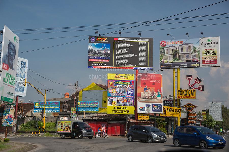 Yogyakarta, Indonesia.  Traffic Intersection, Advertising Billboards.