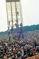 """BNPS.co.uk (01202 558833)<br /> Pic: BarryLevine/Guernseys/BNPS<br /> <br /> !!!ONE TIME USE ONLY!!! PICS ONLY TO BE USED IN RELATION TO THE AUCTION!!!<br /> <br /> Pictured: Crowds climb one of the towers.<br /> <br /> A photo collection offering a rare glimpse of the iconic Woodstock Festival has sold for over £12,000.<br /> <br /> The unique Levine series captured some of the world's most famous rock stars performing at the one-of-a-kind festival in Bethel, New York, in August 1969, including Jimi Hendrix, Janis Joplin, The Who, and Neil Young.<br /> <br /> Barry Levine, now 77, brushed shoulders with many of his subjects, recalling Hendrix's """"amazing sense of humour"""" and Young's disdain for photographers from his home in Florida."""