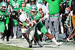 North Texas Mean Green defensive end Jareid Combs (7) in action during the Zaxby's Heart of Dallas Bowl game between the Army Black Knights and the North Texas Mean Green at the Cotton Bowl Stadium in Dallas, Texas.