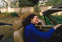Sherry Lansing, pioneering studio executive and first female President of 20th Century Fox, talks on her car phone while driving in Los Angeles, February 1989. Photo by John G. Zimmerman