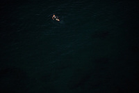 A man swims in the Gulf of Naples on Thursday, Sept. 17, 2015, in Sorrento, Italy. (Photo by James Brosher)