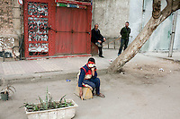 A boy with his face painted with the colours of the Egyptian flag in one of the back streets near Tahrir Square. Throughout Friday, 4 February, anti government protesters protected their positions from pro Mubarak supporters around Tahrir square, the scene of heavy clashes between pro and anti government protesters. Continued anti-government protests take place in Cairo calling for President Mubarak to stand down. After dissolving the government and allowing for talks with opposition parties Mubarak still refuses to step down from power...