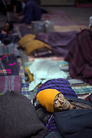 An old man sleeping in the Fatepuri night shelter for the homeless in Old Delhi.