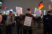 """Nachdem an drei voran gegangenen Baergida-Aufmaerschen mehrere hundert Menschen teilgenommen haben, kamen am Montag den 26. Januar 2015 nur noch ca. 150 Personen. Wieder nahmen viele militante Neonazis aus Berlin und Brandenburg, Hooligans, sog. """"Reichsbuerger"""" teil.<br /> 26.1.2015, Berlin<br /> Copyright: Christian-Ditsch.de<br /> [Inhaltsveraendernde Manipulation des Fotos nur nach ausdruecklicher Genehmigung des Fotografen. Vereinbarungen ueber Abtretung von Persoenlichkeitsrechten/Model Release der abgebildeten Person/Personen liegen nicht vor. NO MODEL RELEASE! Nur fuer Redaktionelle Zwecke. Don't publish without copyright Christian-Ditsch.de, Veroeffentlichung nur mit Fotografennennung, sowie gegen Honorar, MwSt. und Beleg. Konto: I N G - D i B a, IBAN DE58500105175400192269, BIC INGDDEFFXXX, Kontakt: post@christian-ditsch.de<br /> Bei der Bearbeitung der Dateiinformationen darf die Urheberkennzeichnung in den EXIF- und  IPTC-Daten nicht entfernt werden, diese sind in digitalen Medien nach §95c UrhG rechtlich geschuetzt. Der Urhebervermerk wird gemaess §13 UrhG verlangt.]"""